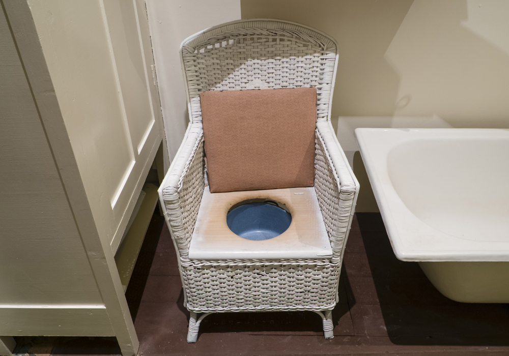A seated commode chair containing a chamber pot was for inside use, as an alternative to the regular outside toilet.