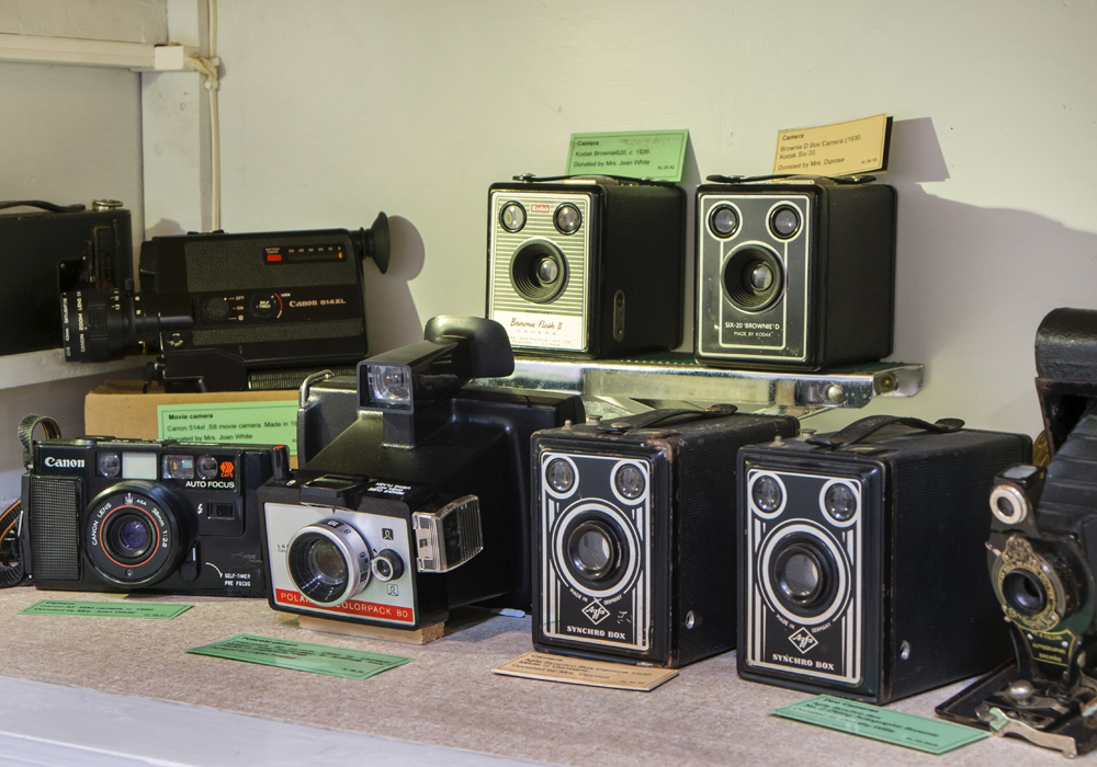 A range of cameras dating back to c.1930. ~ Donated by Mrs. Diprose, Mrs. Joan White, Logan Howlett and others.