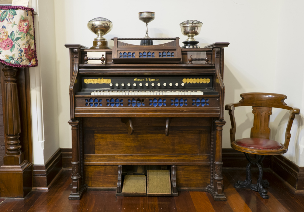 Pedal organ, powered by foot operated bellows. Purchased in 1978 by the Shire of Cockburn. ~ Donated by the City of Cockburn.