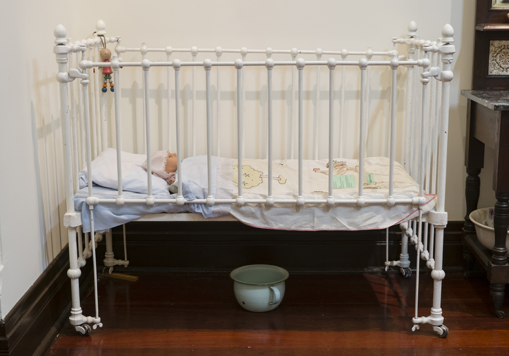 Iron baby cot c.1900-1915. ~ Donated by David and Hillary Armstrong.