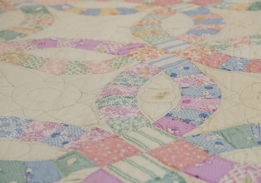 Early century Wedding Ring quilt, hand made in the Quaker tradition. On loan from Mrs. Arlene Crane.