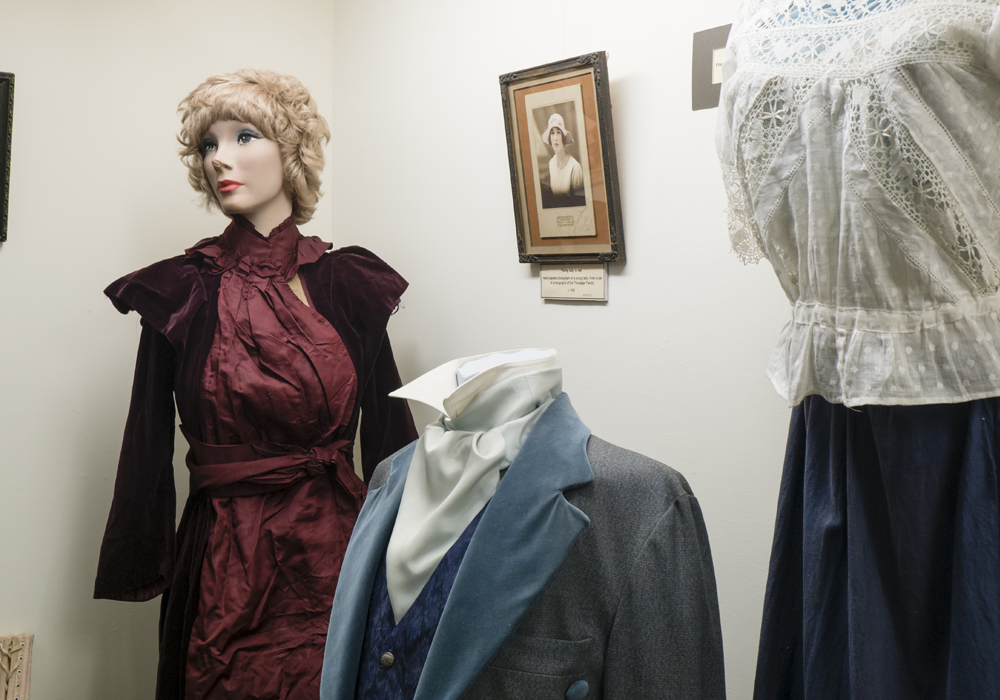 Assorted clothing, including a Gentleman's outfit c.1820 and a ladies cotton blouse c.1920.