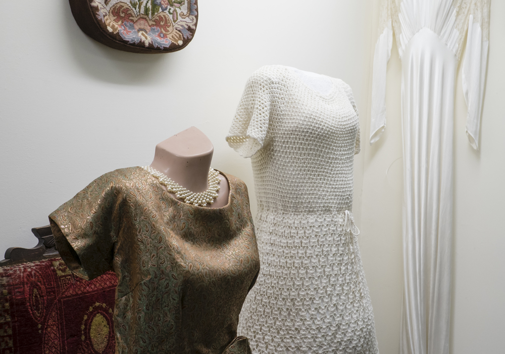 Assorted clothing, including a Ball gown c.1935 and the Wedding dress worn by Audrey Austin.