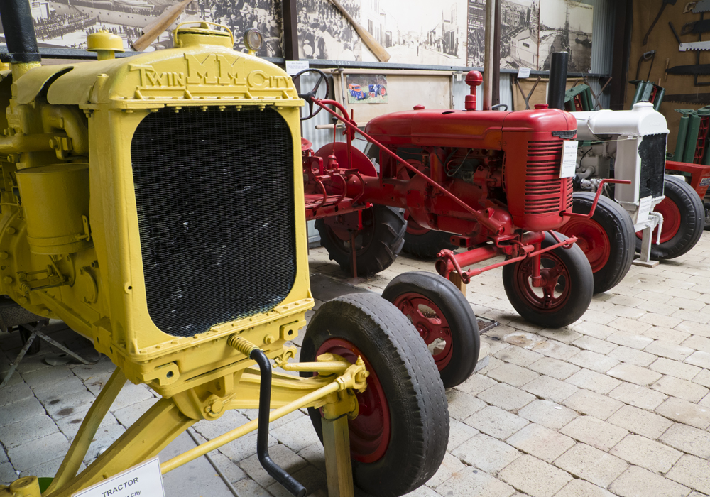 Tractors, including Twin M M City c.1930, Farmall c.1948 and Fordson c.1923.