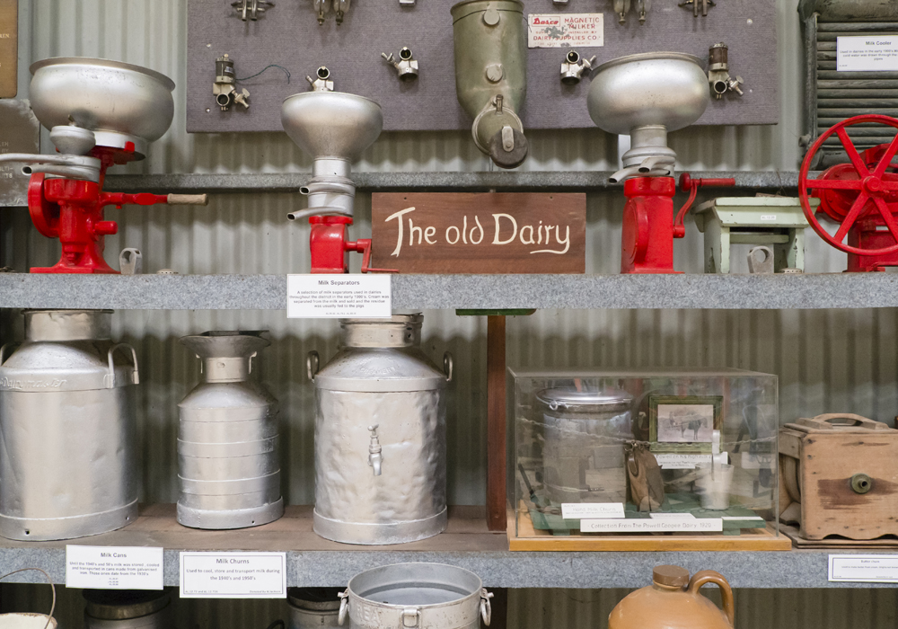A range of dairy equipment, including Milk separators and milk and butter churns.