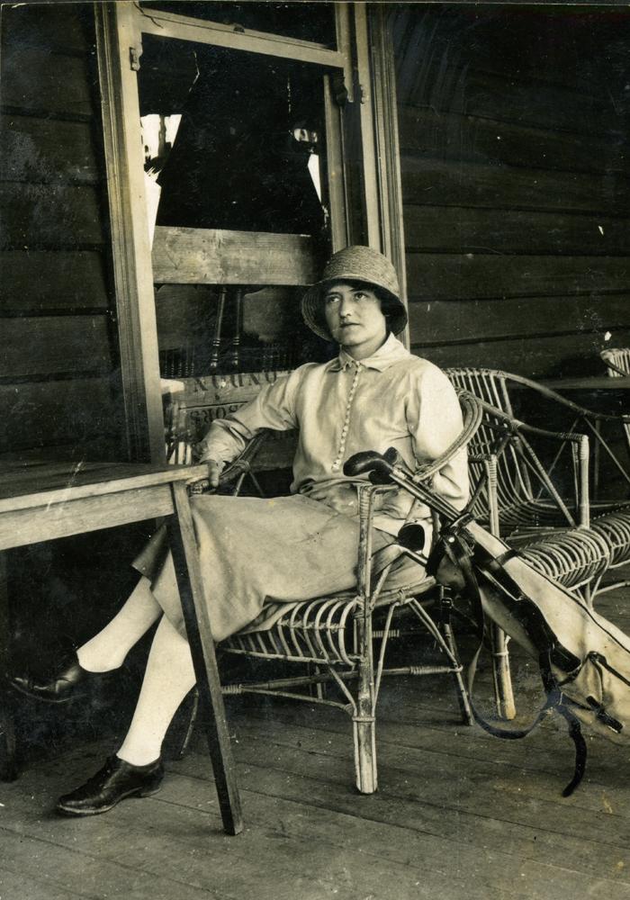Verna Manning on a verandah.