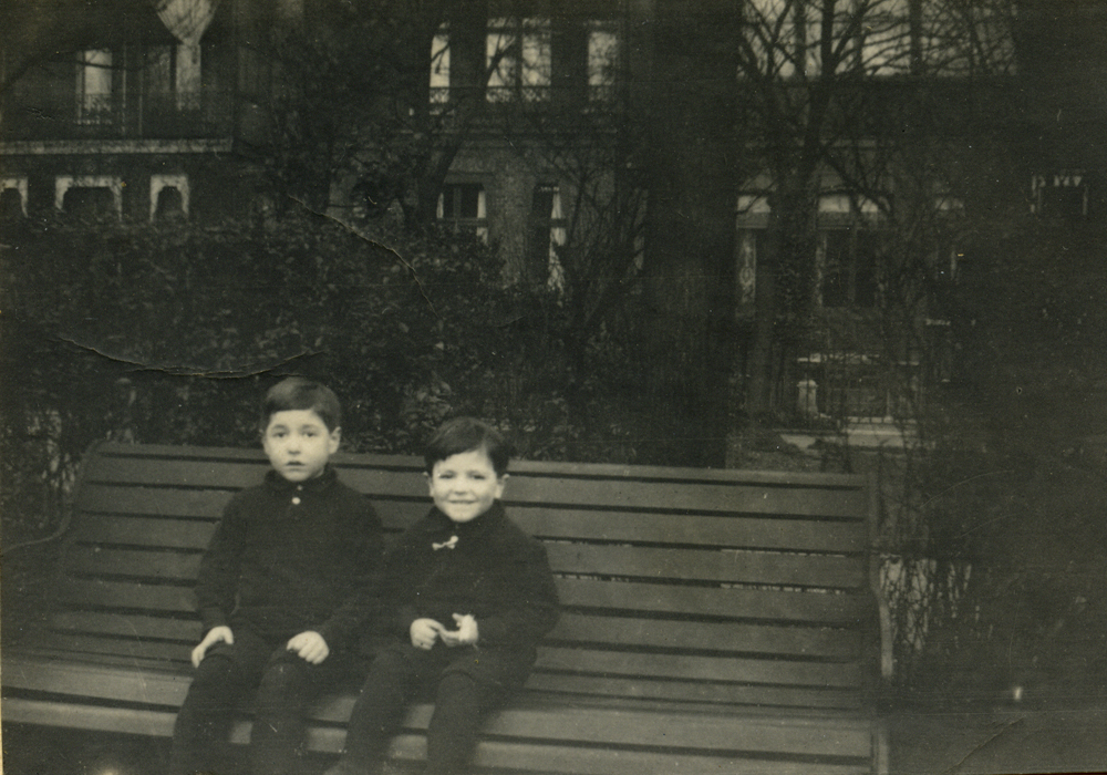 Ian and Colin Manning seated on bench. Location unknown.