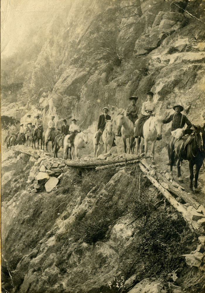 Group of riders descending into the Colorado Canyon. Victor Manning on World Tour.
