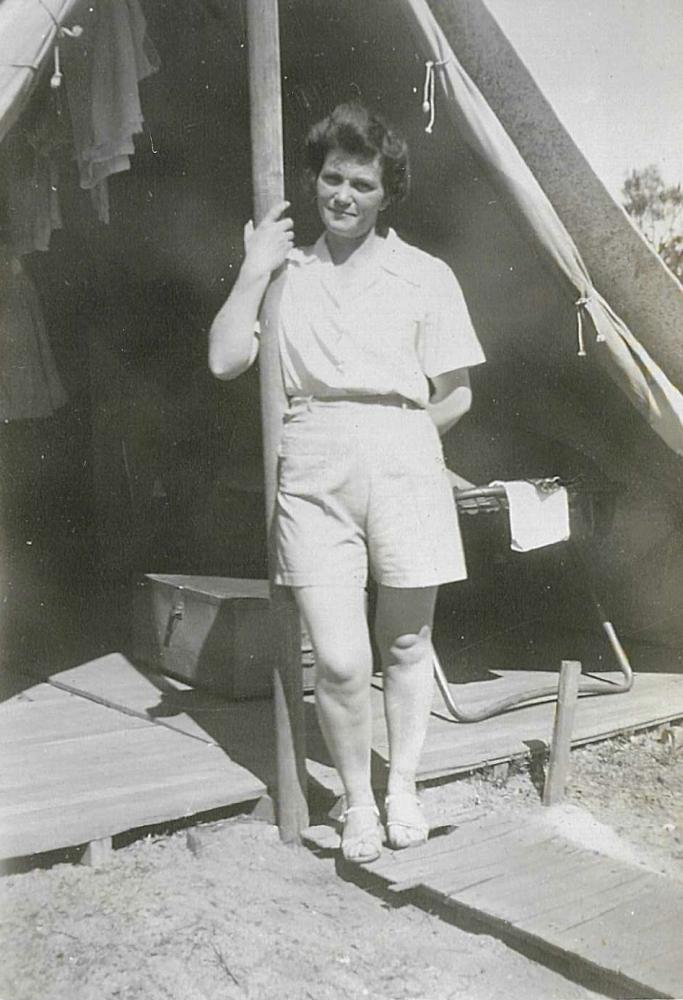 AWAS woman in front of her tent at Bibra Lake, 1944.
