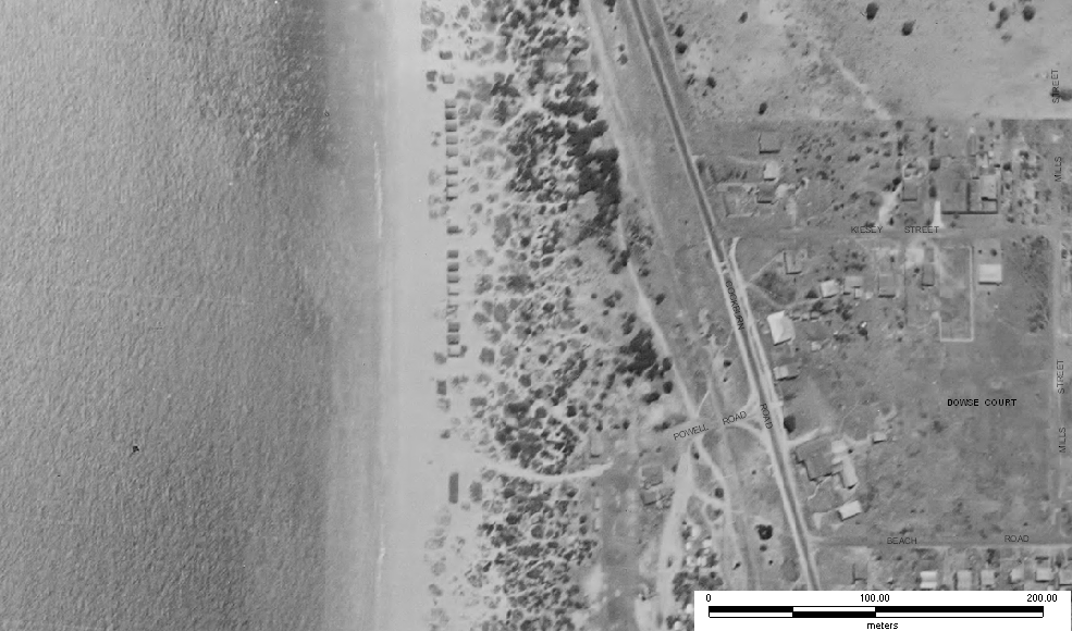 Aerial view of the boat sheds in the dunes at Coogee Beach, 1953. © City of Cockburn Aerial Mapping.